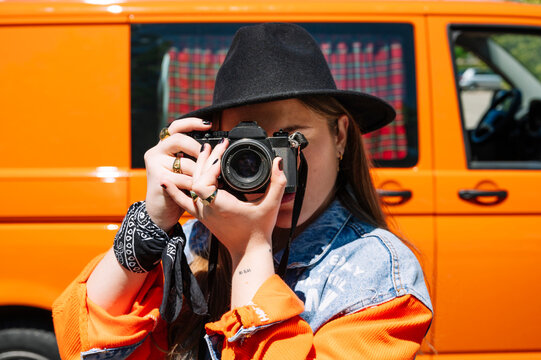Young woman taking pictures with camera