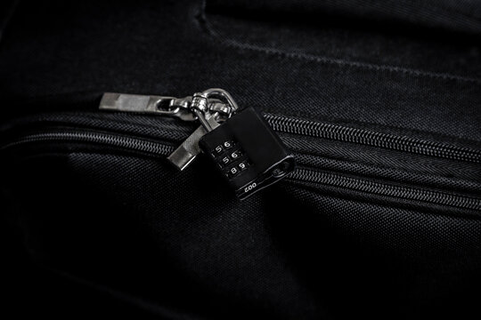 TSA lock on black bag