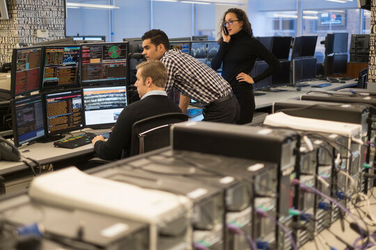 Young traders working in stock market