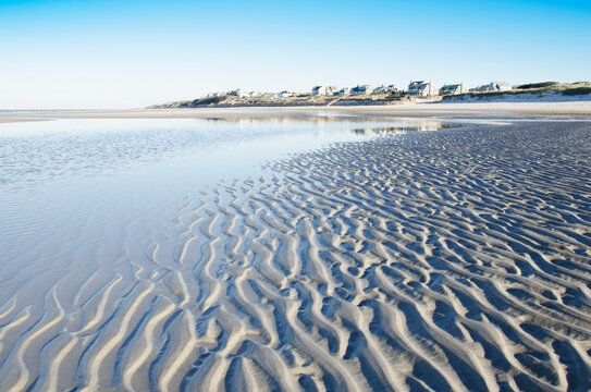 Beach at low tide with rippled sand