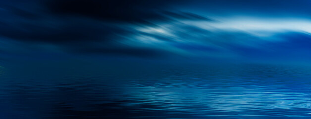 Night sky, horizon at sunset, moonlight, clouds, waves reflected in water. Empty sea landscape, natural scene. Night view.