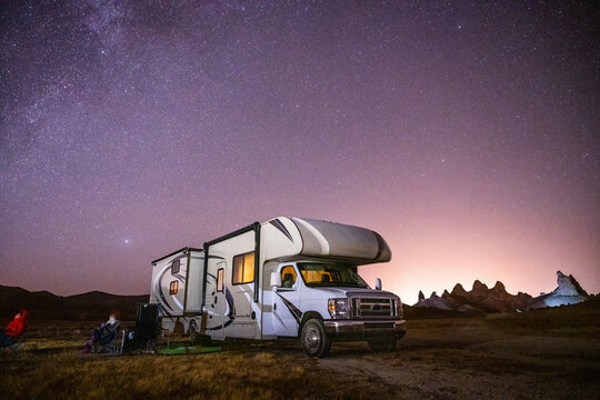 Campers gaze at Milky Way by their RV