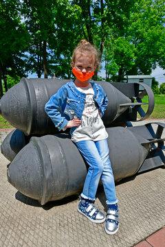 Little girl child walks through the military museum.
