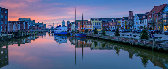 North Sea port city of Husum at Christmas time by sunset.