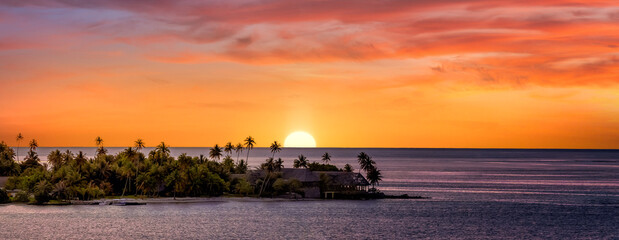 Sunset in Tahiti with pink sky