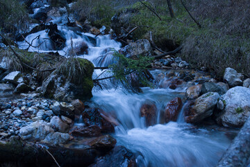 the silky effect that is created in winter on a stream in the middle of the woods in a mountain location