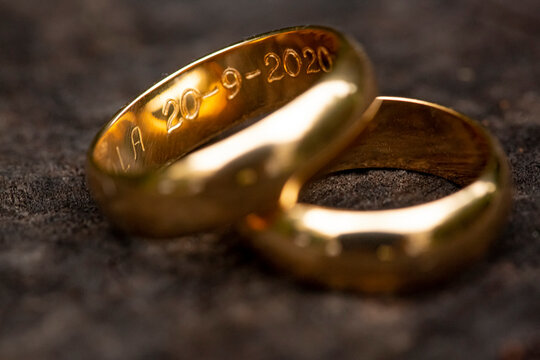 golden ring with engraved dates