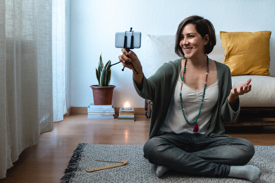 Young woman streaming online for meditation webinar lesson at home - Mindfulness online lesson influencer concept