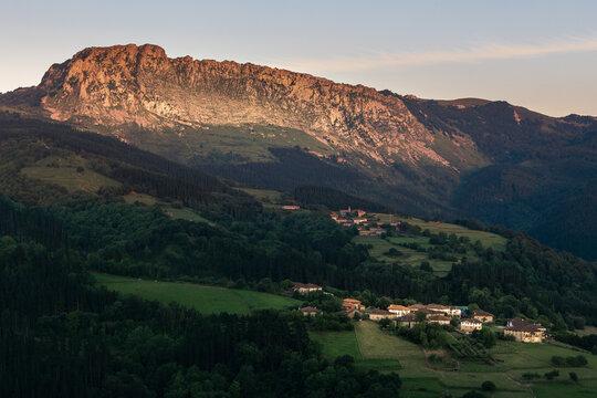 Itxina mountain with Zaloa and Urigoiti villages at sunset. Orozko, Basque Country