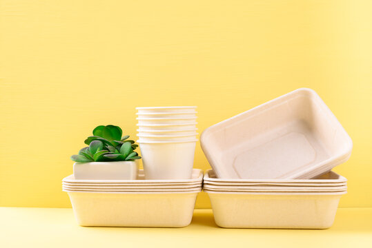Biodegradable, Compostable, Disposable or Eco friendly utensil bowl and cup on yellow background, Sustainable concept