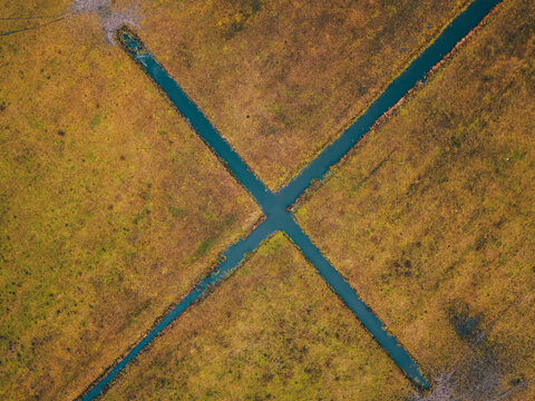 Aerial drone shot of the top-down view of the X-shaped irrigation on the farm fields