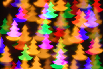 colorful fir trees illumination for holiday or abstract boke background