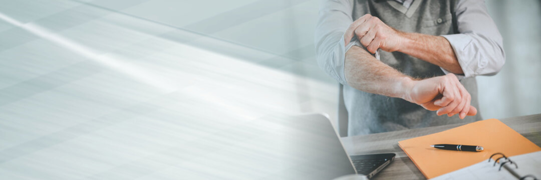 Businessman rolling up his sleeves; panoramic banner