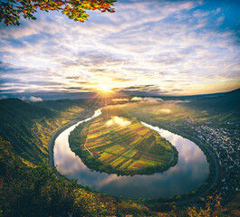 The Moselle loop, a beautiful river in Germany, makes a 180 degree loop. with vineyards and a great...