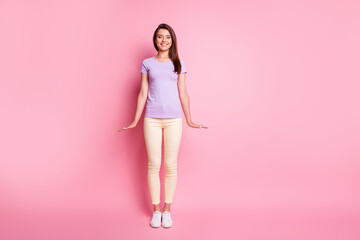 Full size photo of amazing lady stand straight dressed purple t-shirt isolated on pink color...