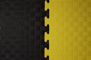 Black and yellow puzzle, rubber Mat, background, texture close-up