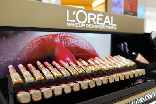 Loreal cosmetic products sit on display for sale in Changi Airport new terminal 4, Singapore. It is world's largest cosmetics company in France. SINGAPORE - APR 22, 2018.