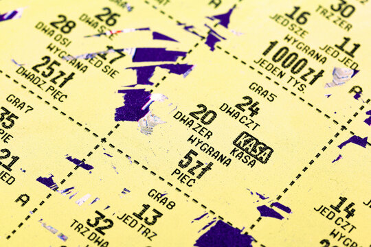 Simple Polish lottery ticket, scratch card, scratch off detail, extreme closeup, macro. Prize numbers, money figures. Gambling, lotteries abstract concept
