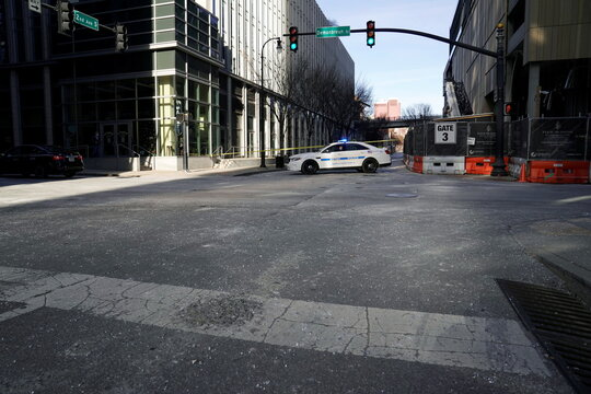 Broken glass litters the street near the site of an explosion that occurred the day before in Nashville