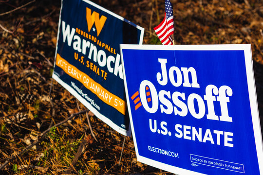 LAWRENCEVILLE, UNITED STATES - Dec 22, 2020: Georgia Senate runoff election signs along the side of the road near a polling location