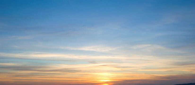 A mesmerizing view of the sunset in shades of orange on a clear sky