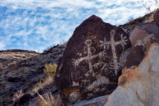 Historical petroglyphs carved on desert rocks by native indigenous people near Las Vegas, Nevada