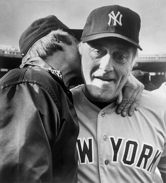 New York Yankees pitcher Phil Niekro is kissed by his brother Joe in Toronto