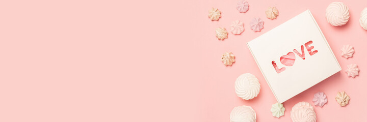 Gift box and sweets on a pastel pink background. Composition Valentine's Day. Flat lay, top view. Banner