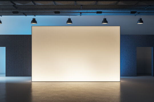 Modern museum interior with illuminated billboard
