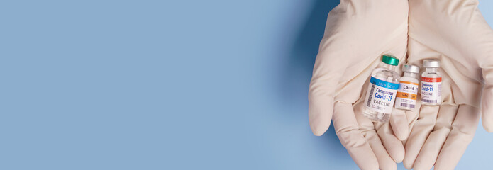 COVID-19 Vaccines for developing country concept. Hand of a Researcher holding Coronavirus...