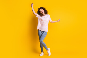Photo portrait full body view of screaming woman dancing isolated on vivid yellow colored background