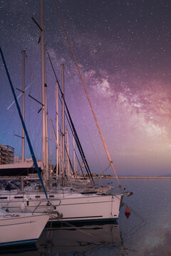 Milky way and the galaxy over the coast of Volos, Greece