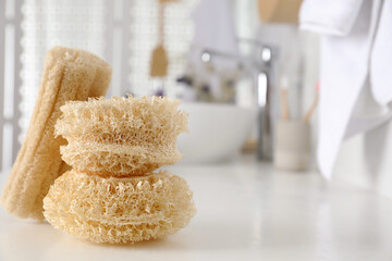 Wall Mural - Natural loofah sponges on table in bathroom. Space for text