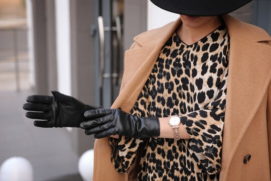 Young woman in stylish black leather gloves outdoors, closeup