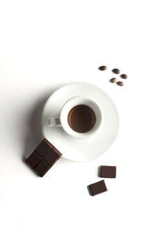Cup of coffee with chocolate  on white background. Cup of espresso.Top view
