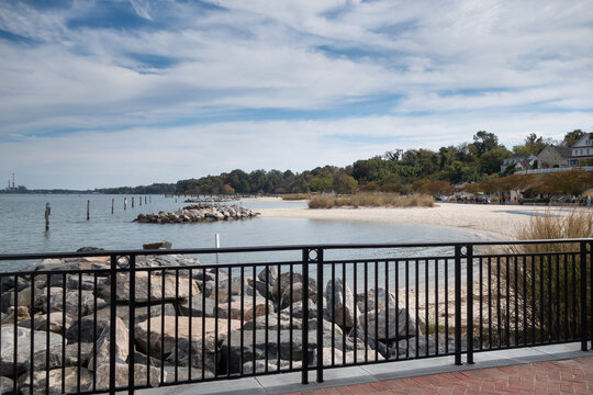 The railing along the York River in Yorktown, VA with the view of Yorktown Beach
