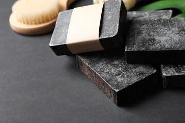 Wall Mural - Natural tar soap on black table, closeup