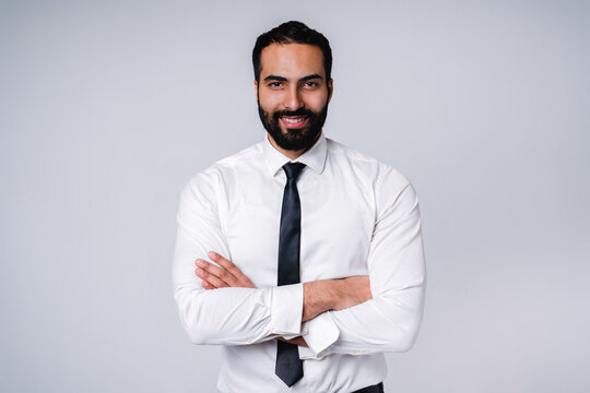 Successful 25s Middle East businessman in formal shirt isolated over grey background