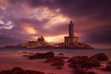 Kanyakumari - Vivekananda Rock Memorial Thiruvalluvar Statue in the evening with a colorful and cloudy sky background.