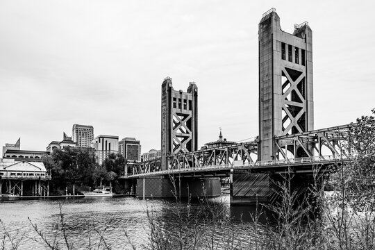 Tower Bridge and city skyline in Sacramento, California, USA beyound tree branches during the autumn season