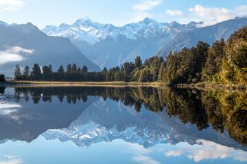 Mount Tasman (Horokoau) and Mount Cook (Aoraki) reflected in Lake Matheson near Fox Glacier in the Southern Alps of New Zealand