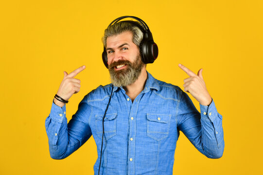 look at me. Music beat for energetic mood. his favorite song. enjoy excellent sound song in earphones. good mood playlist. Man with headset. bearded man hipster in headset. listen audio book