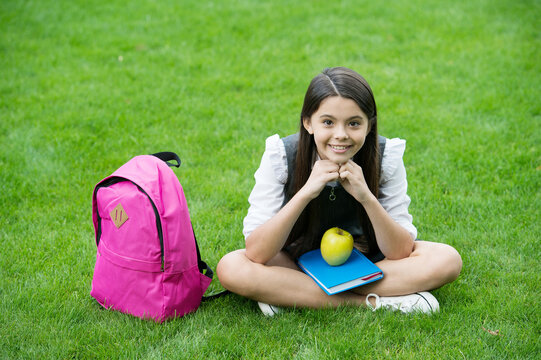 You are what you eat. Happy child sit on green grass. School snack. Vegetarian diet. Health education. Diet and dieting. Healthy eating. Balanced menu. The coolest way to take your vitamin