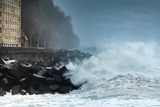 Waves breaking on the New Promenade of Donostia/San Sebastian, Spain