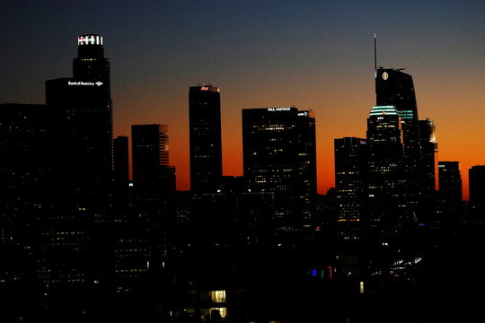 The Los Angeles city skyline is seen after sunset during a surge in positive coronavirus disease (COVID-19) cases in Los Angeles