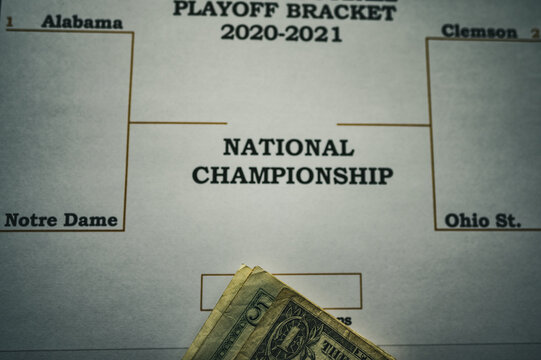 Tiffin, Iowa, USA: 12-2020:  Printed out NCAA Football Championship bracket with loose money on top