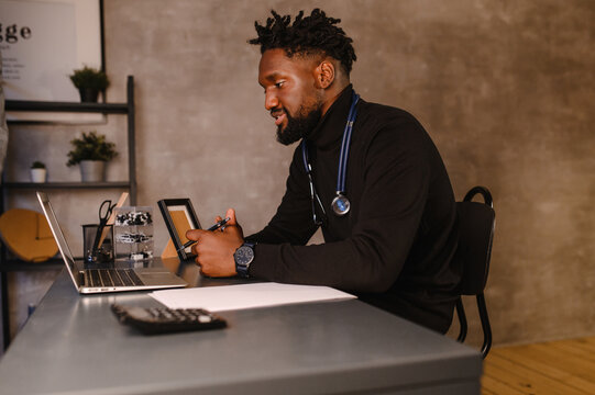 telehealth with virtual doctor appointment and online therapy session. Black doctor online conference