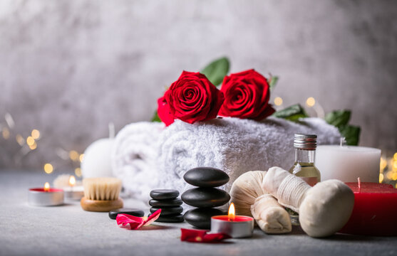 Wellness decoration, spa massage setting,  oil on stone background. Valentine's Day Zen and relax concept.