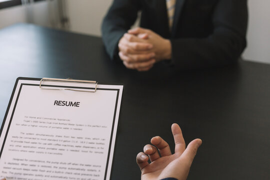 job interview in office, focus on resume writing tips, employer reviewing good cv of prepared skilled applicant, recruiter considering application, hr manager making hiring decision