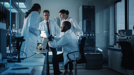 Medical Science Laboratory with Diverse Multi-Ethnic Team of Microbiology Scientists Have Meeting...